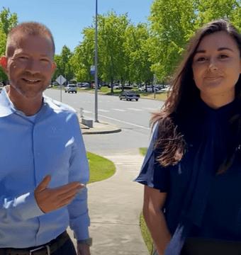 Ryan Kelly and Julianna Ferrara discuss ADA websites while walking outside.
